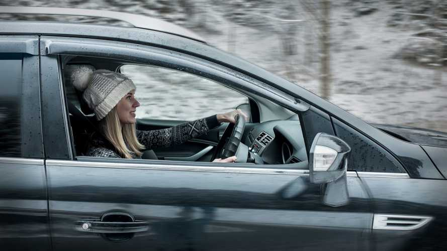 Woman driving car on a snowy winter day