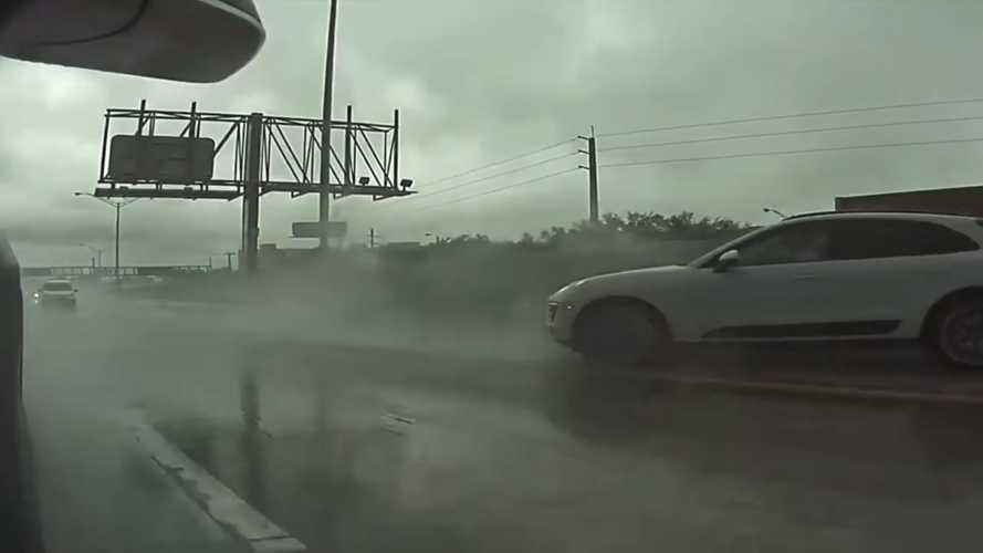 TeslaCam shows you a Porsche Macan hydroplaning and hitting wall