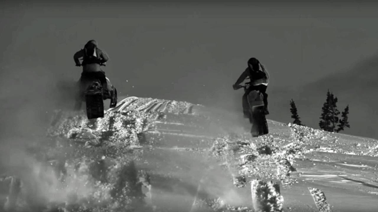 Video of the Day: Snowmobile vs Snow Bike