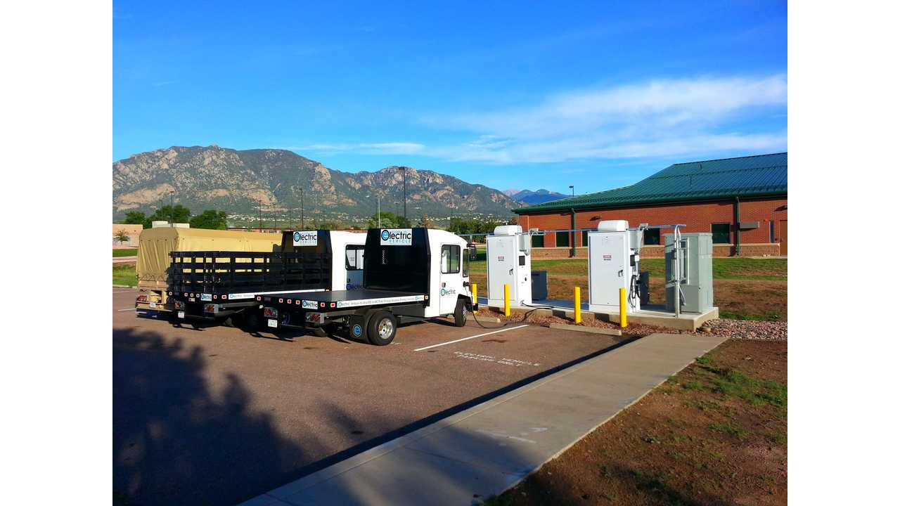 Burns & McDonnell Bi-directional EV Chargers at Fort Carson, Colorado feeding (or being fed by) electric trucks.
