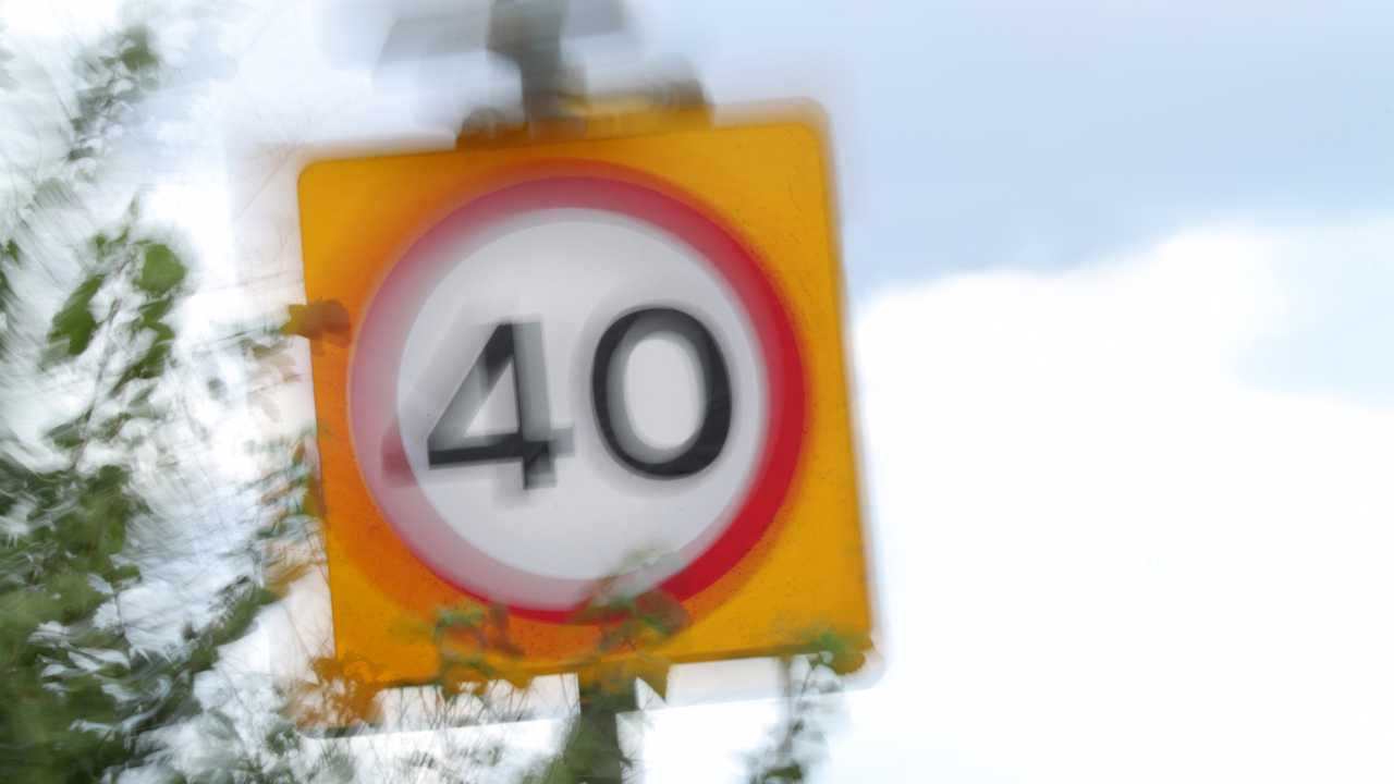 Speed limit sign blurred to show speed