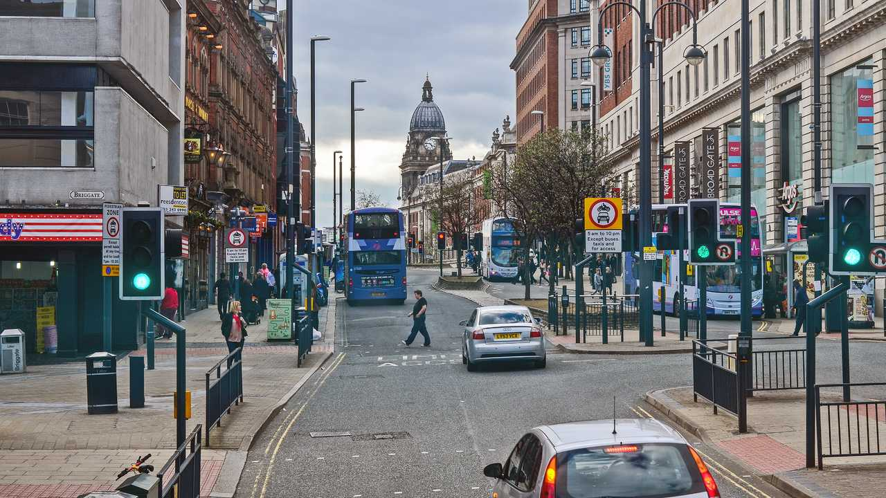 Traffic and people at Leeds city centre UK