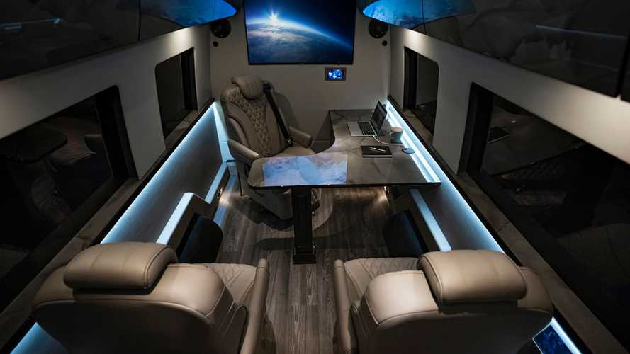 This brilliant executive limo has a corner office with L-shaped desk
