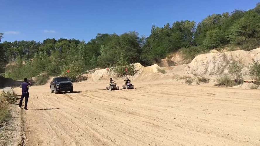 Watch Rivian R1T Truck Prototype With Ford F-150 Body Race Suzuki ATVs