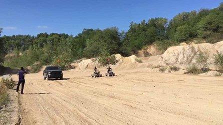 Watch Rivian R1T Truck Prototype With Ford F-150 Body Race Suzuki ATVs