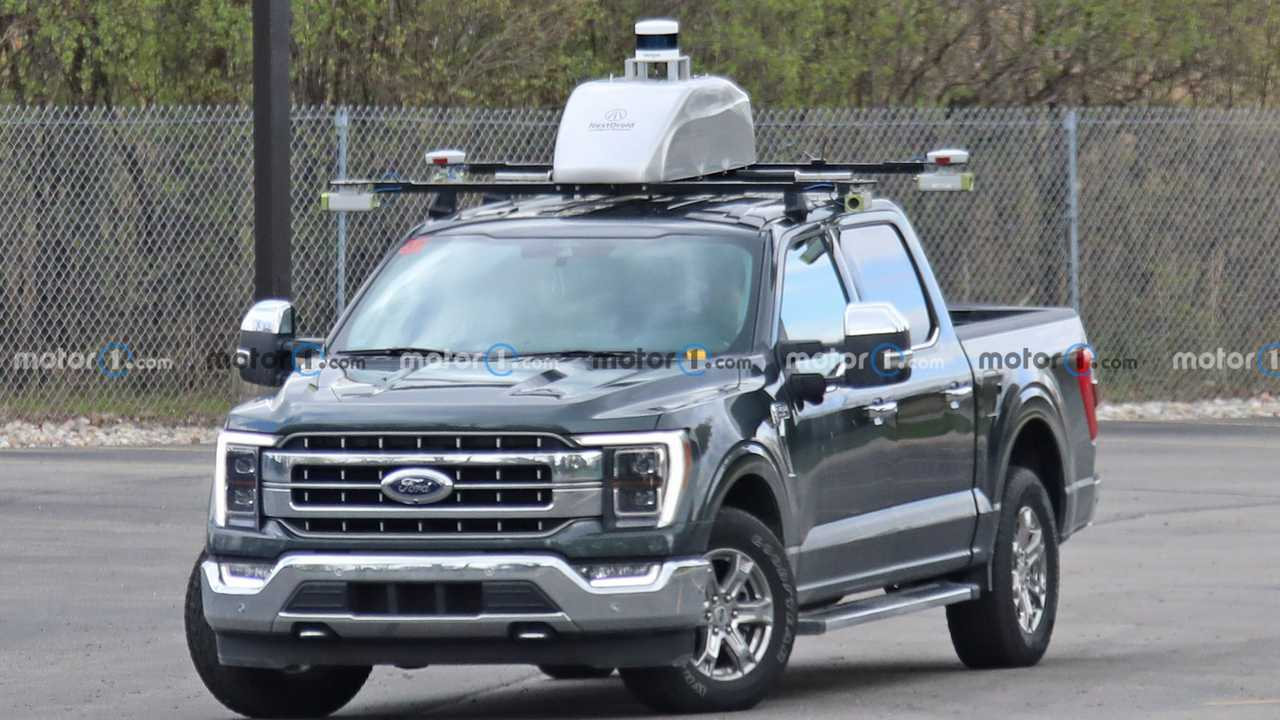 This Ford F-150 test vehicle has a complex autonomous vehicle module on its roof, possibly testing cameras and sensors.