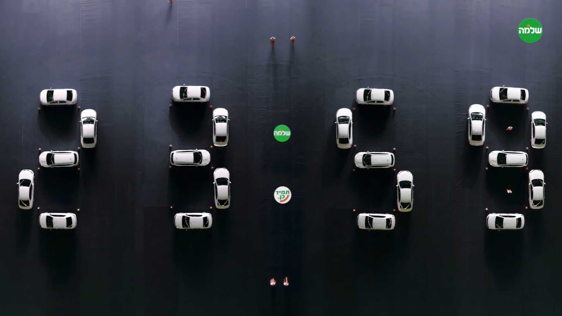 Check out this clock made entirely of cars being parked