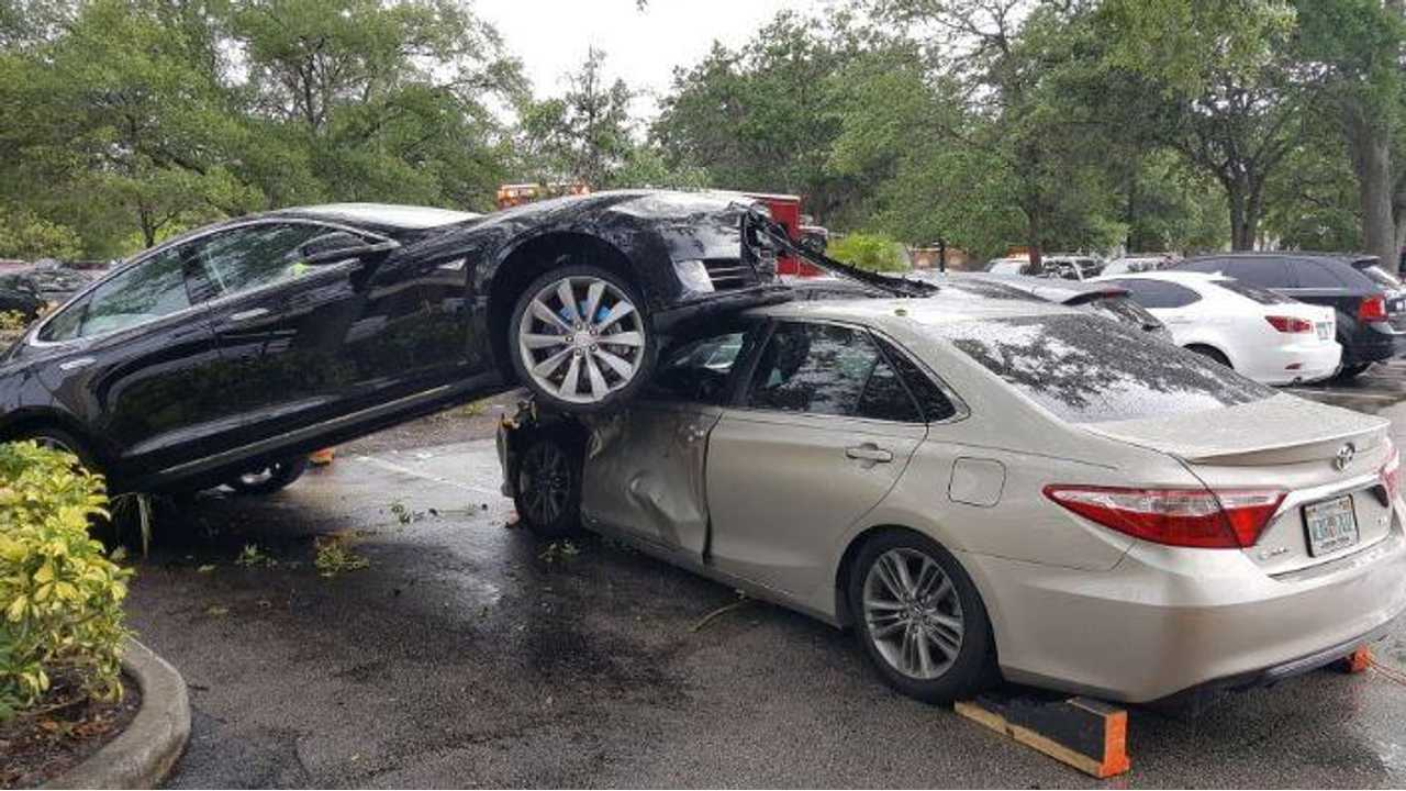 Tesla Model S Jumps Curb, Climbs On Top Of Toyota Camry