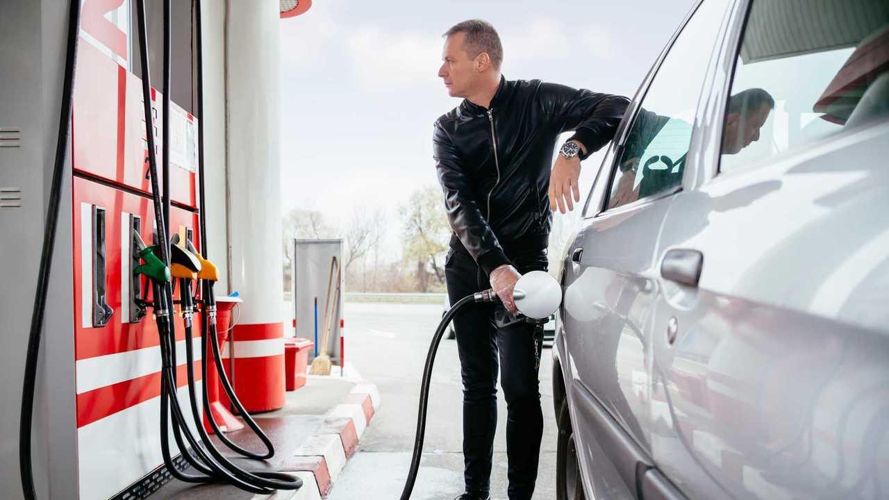 Man at petrol station filling up