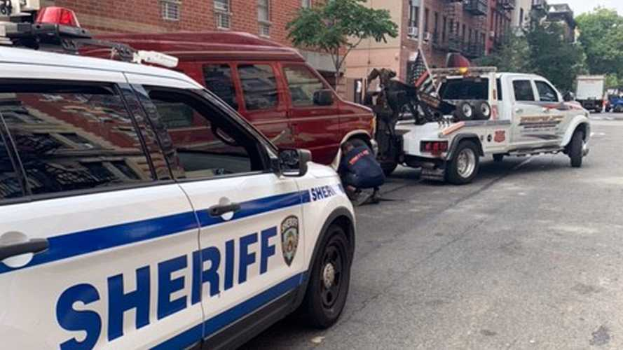 NY Police Bust Ring Of Vans Parked On Street Used As Airbnb Rentals