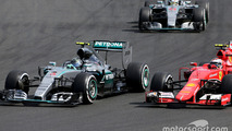 Nico Rosberg, Mercedes AMG F1 Team and Kimi Raikkonen, Scuderia Ferrari
