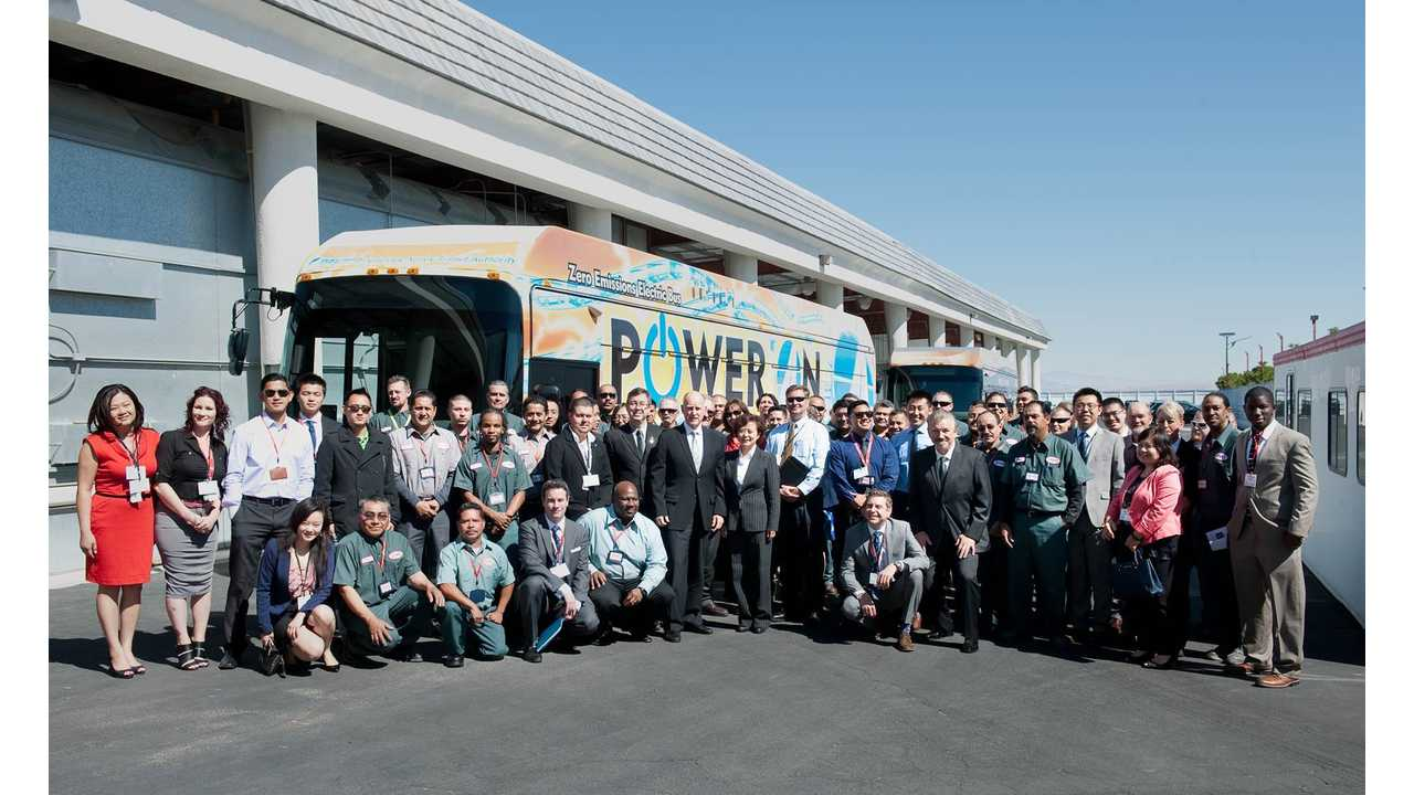 California Governor Jerry Brown stands with the American employees of BYD Motors at the April 2014 Unveiling Ceremony of the First American-Made, Long-Range, Electric Bus