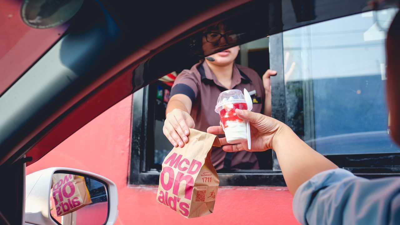 Driver receiving food from McDonalds drive thru