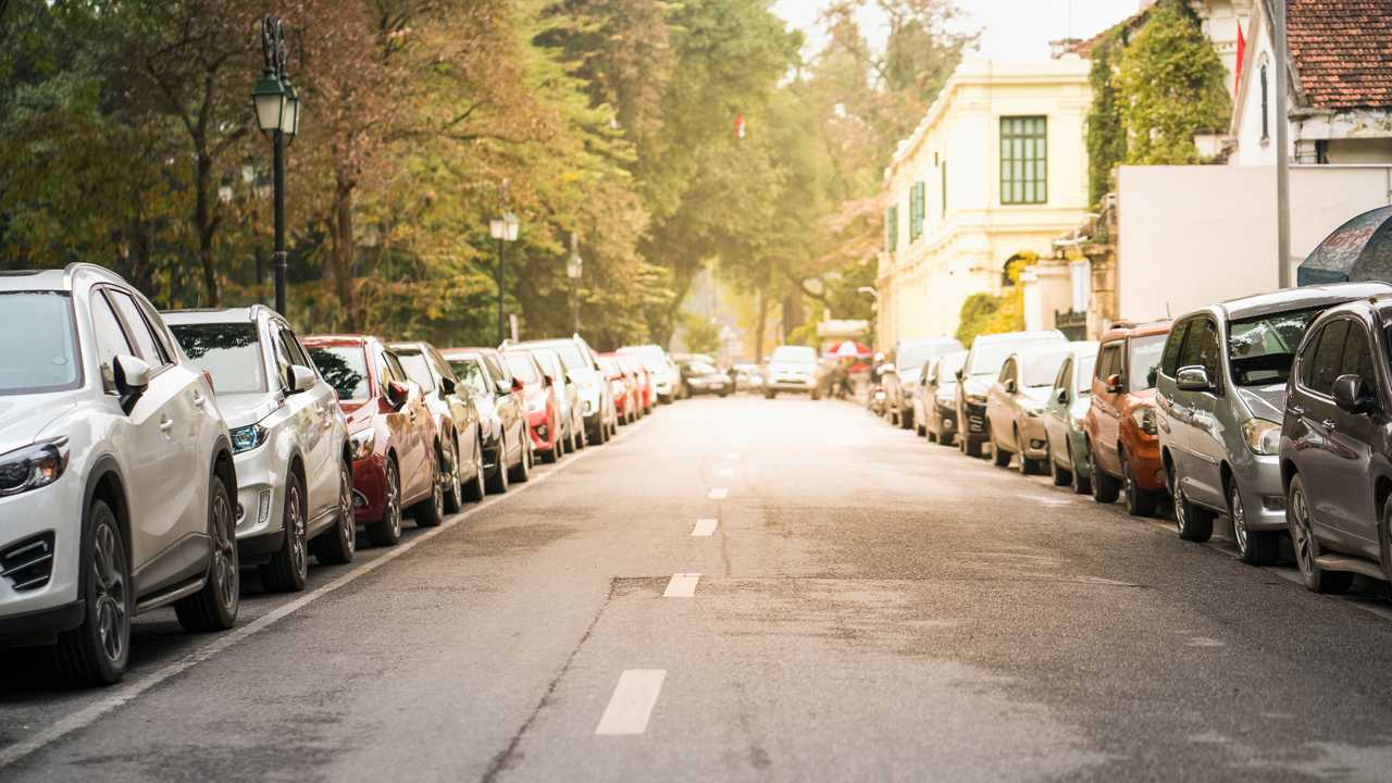Cars parked on urban street side