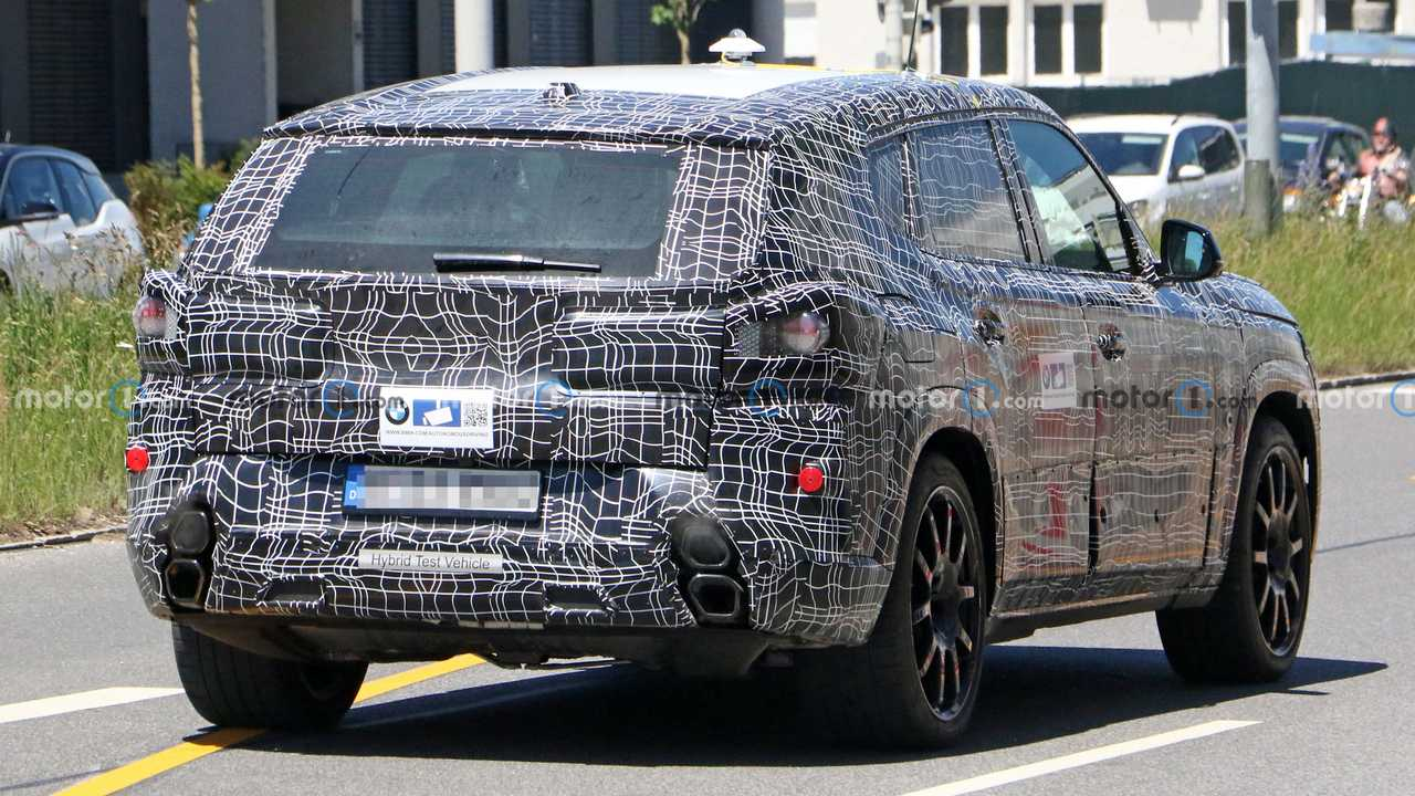 bmw x8 spied with stacked exhaust