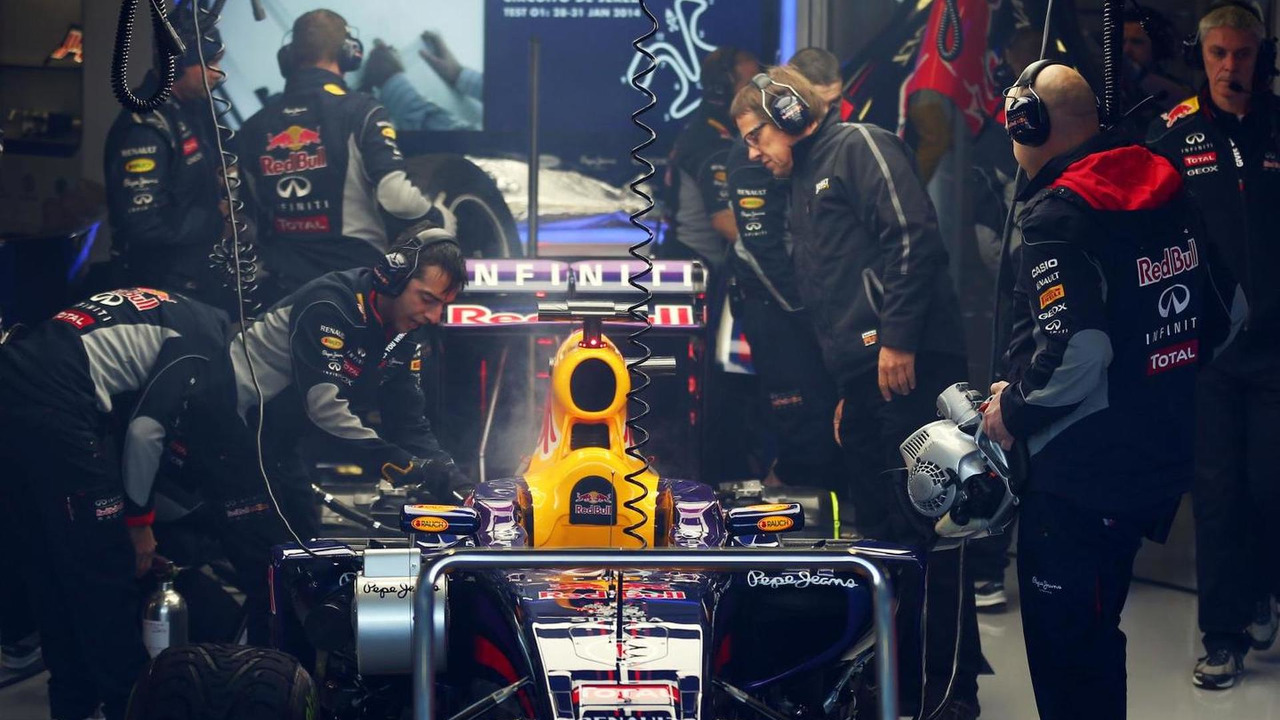 Red Bull Racing RB10 of Sebastian Vettel smoking in the garage 29.01.2014 Formula One Testing Jerez Spain