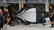 Lotus F1 E21 floor is carried into the pit garage 25.07.2013 Hungarian Grand Prix