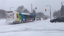 SUVs Pulling Bus Stuck In Snow
