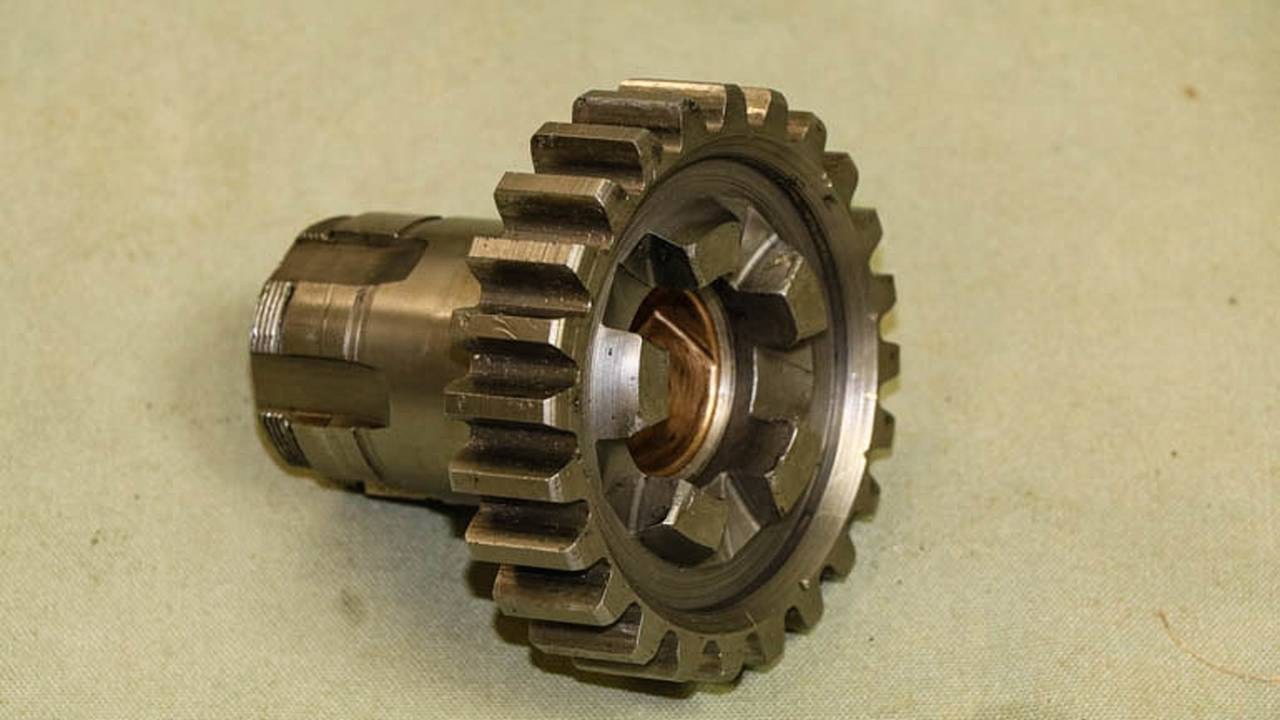 The main drive gear transfers power out of the transmission and to the rear wheel.