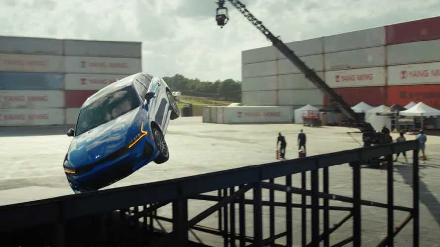 Watch a Kia K5 land s flat spin 360-degree jump between two ramps