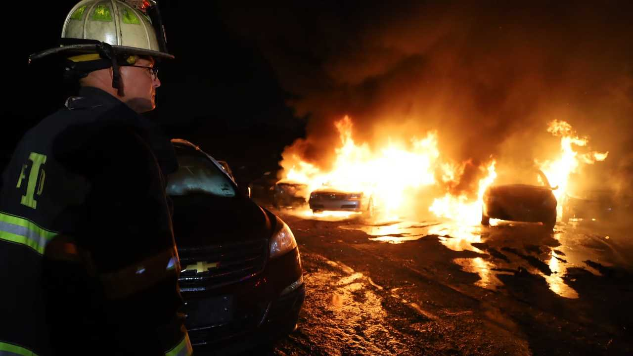 firefighter and burning cars