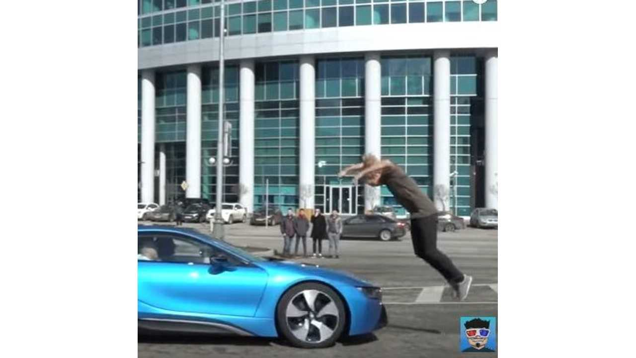 Stuntman Does Front Flip Over Moving BMW i8 - Video
