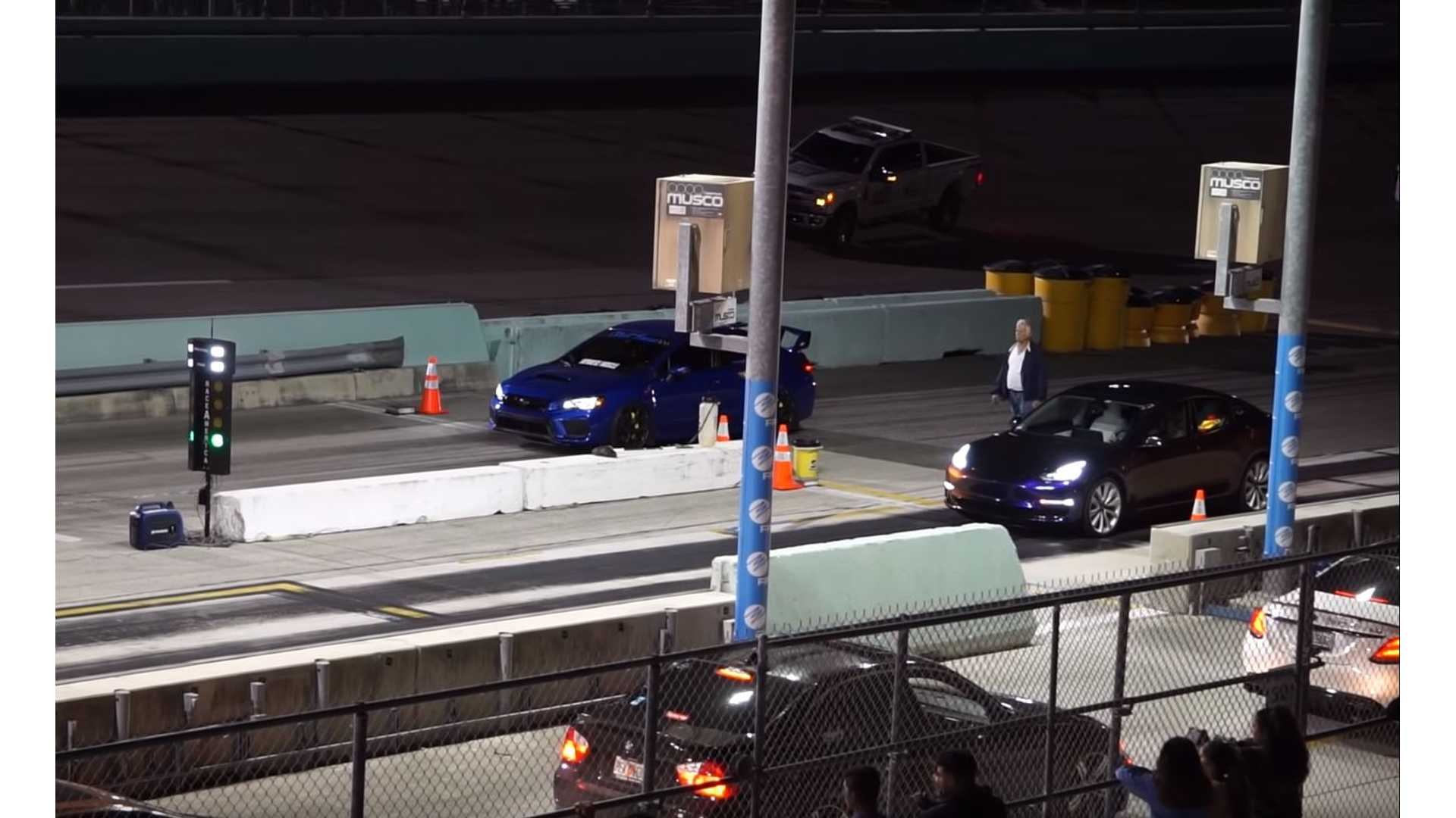 Watch Tesla Model 3 Destroy Subaru WRX STI In Drag Race