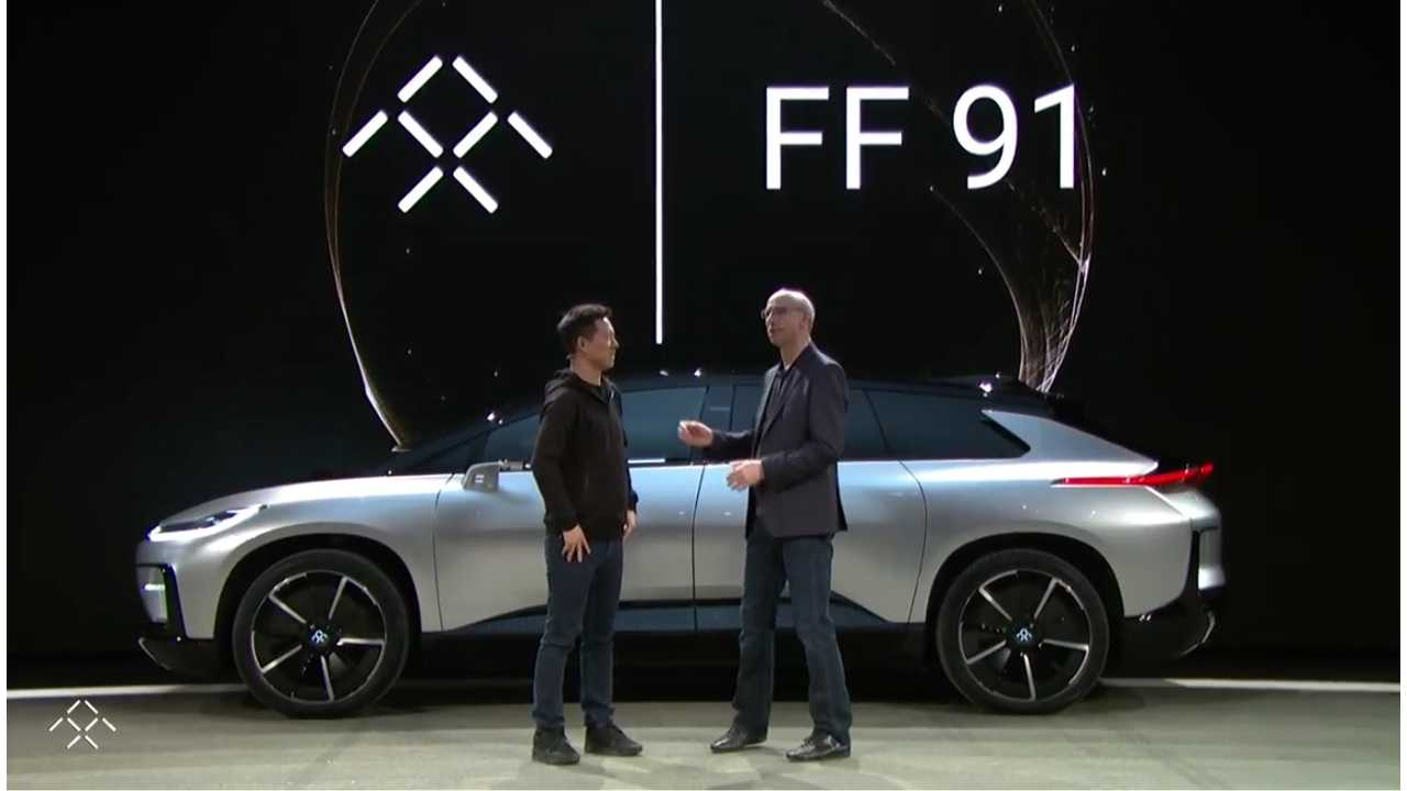 Faraday Future's Jia Yueting and Nick Sampson in front of the FF 91 at its live debut this past January