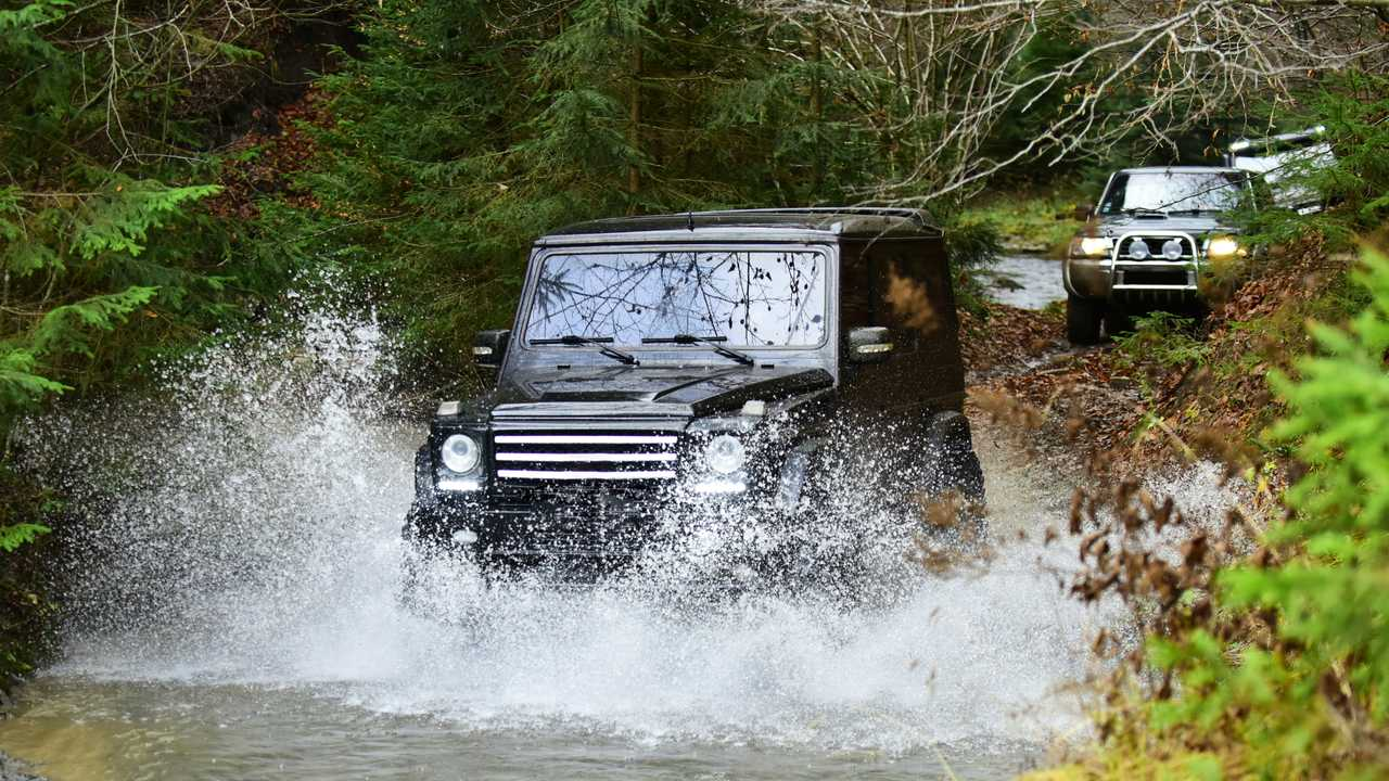 Extreme driving with SUVs or offroad cars crossing stream