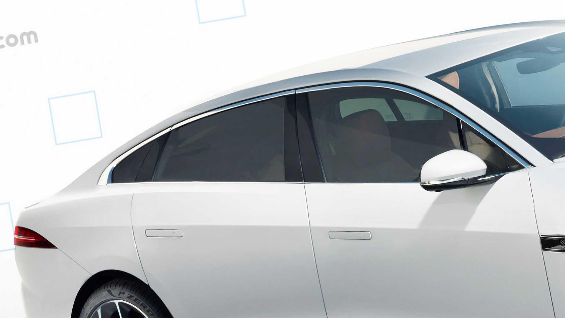 Jaguar Teases New Xj At Land Rover Defender Debut