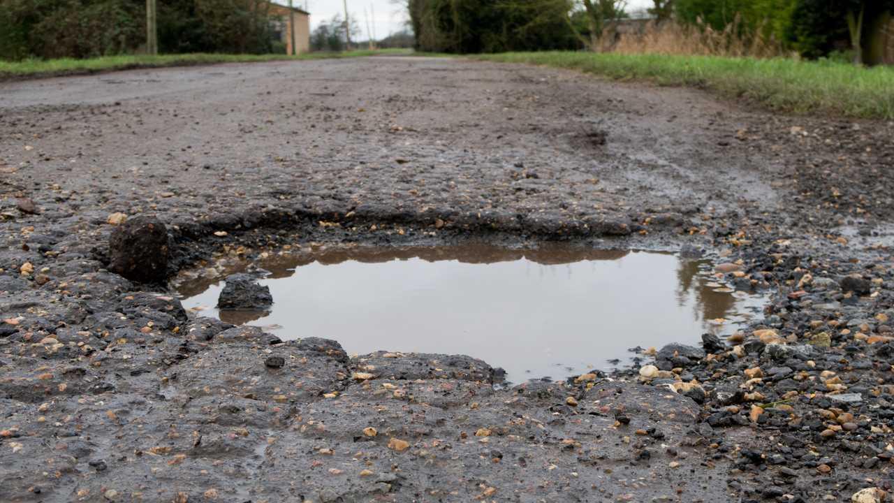 Large deep road pothole in Wisbech Norfolk UK