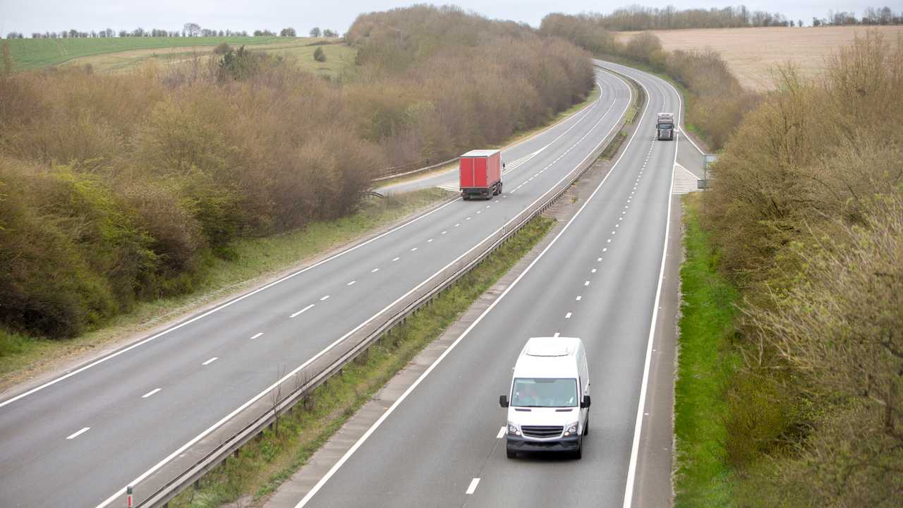 Commercial vehicles driving on quiet motorway