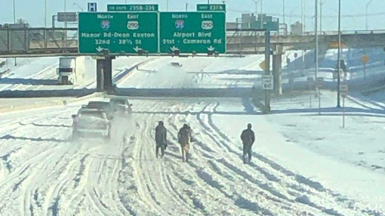People walking on snow-covered freeway in Austin, Texas.