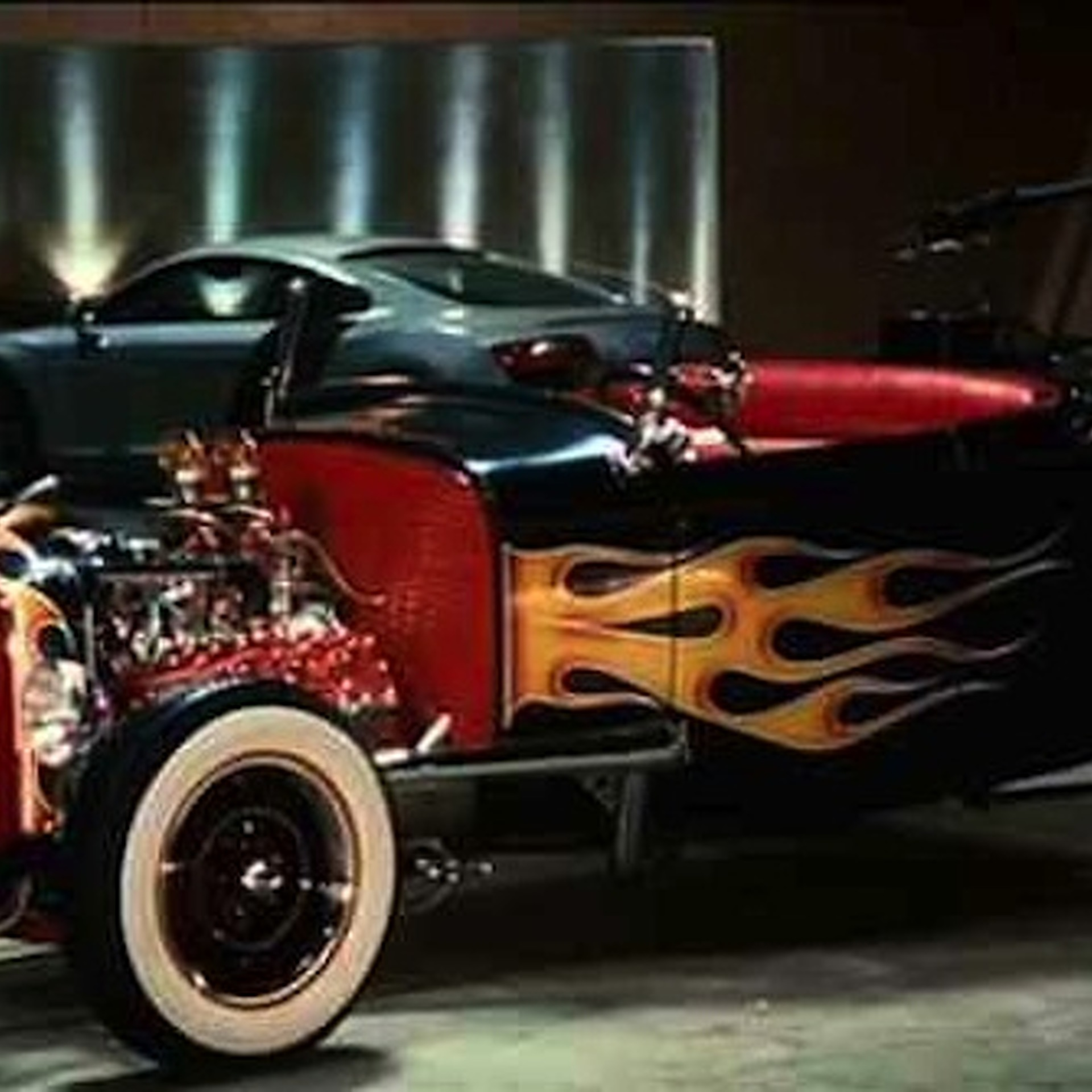 A closer look at the cars in iron man 39 s garage for Garage auto star antony