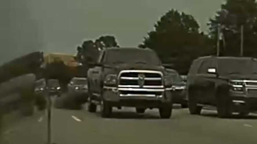 Watch Diesel Ram Truck Attempt To Coal Roll Alert & Funny Tesla Driver