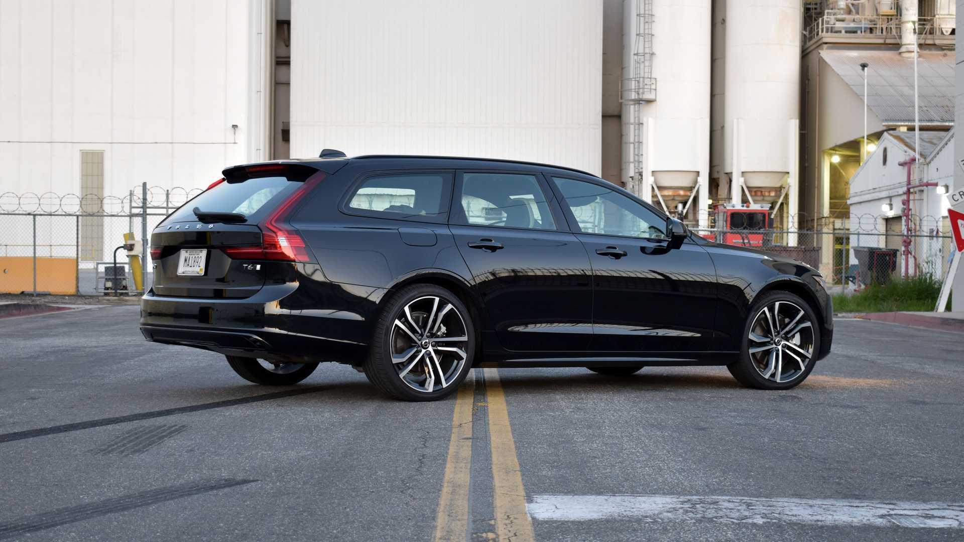 2021-volvo-v90-t6-r-design-awd-exterior-rear-quarter.jpg