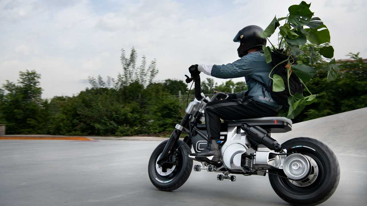 BMW Motorrad Concept CE 02 - Left Side Riding with Plant and Skateboard