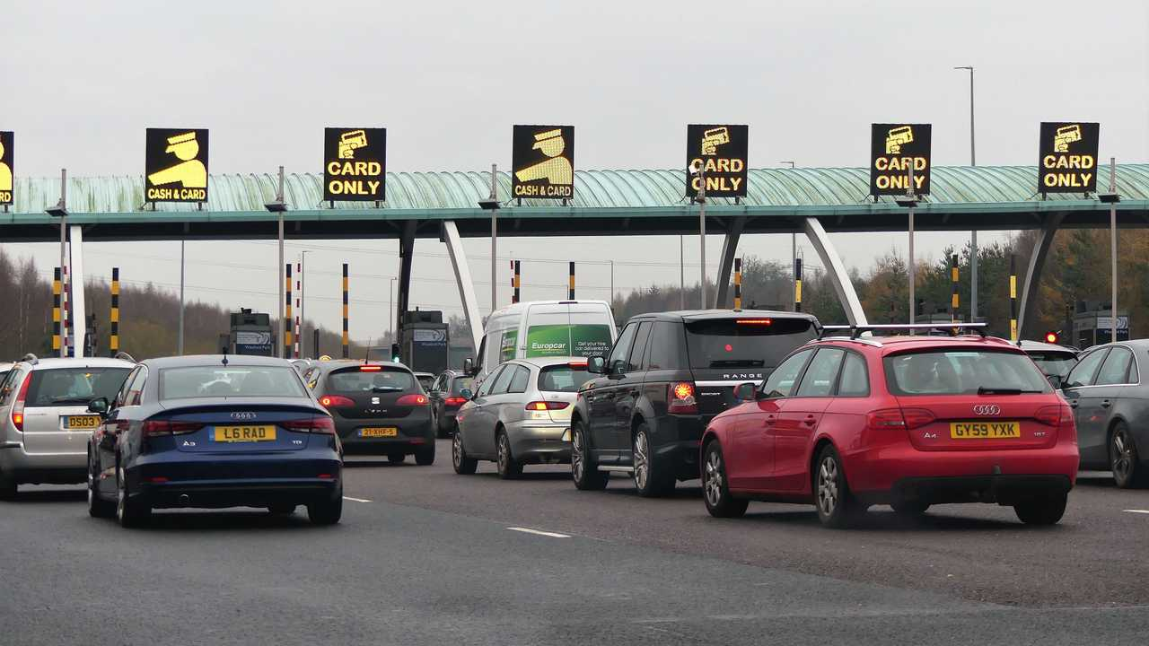 Cars queuing at M6 Toll motorway plaza at Weeford Park West Midlands England UK