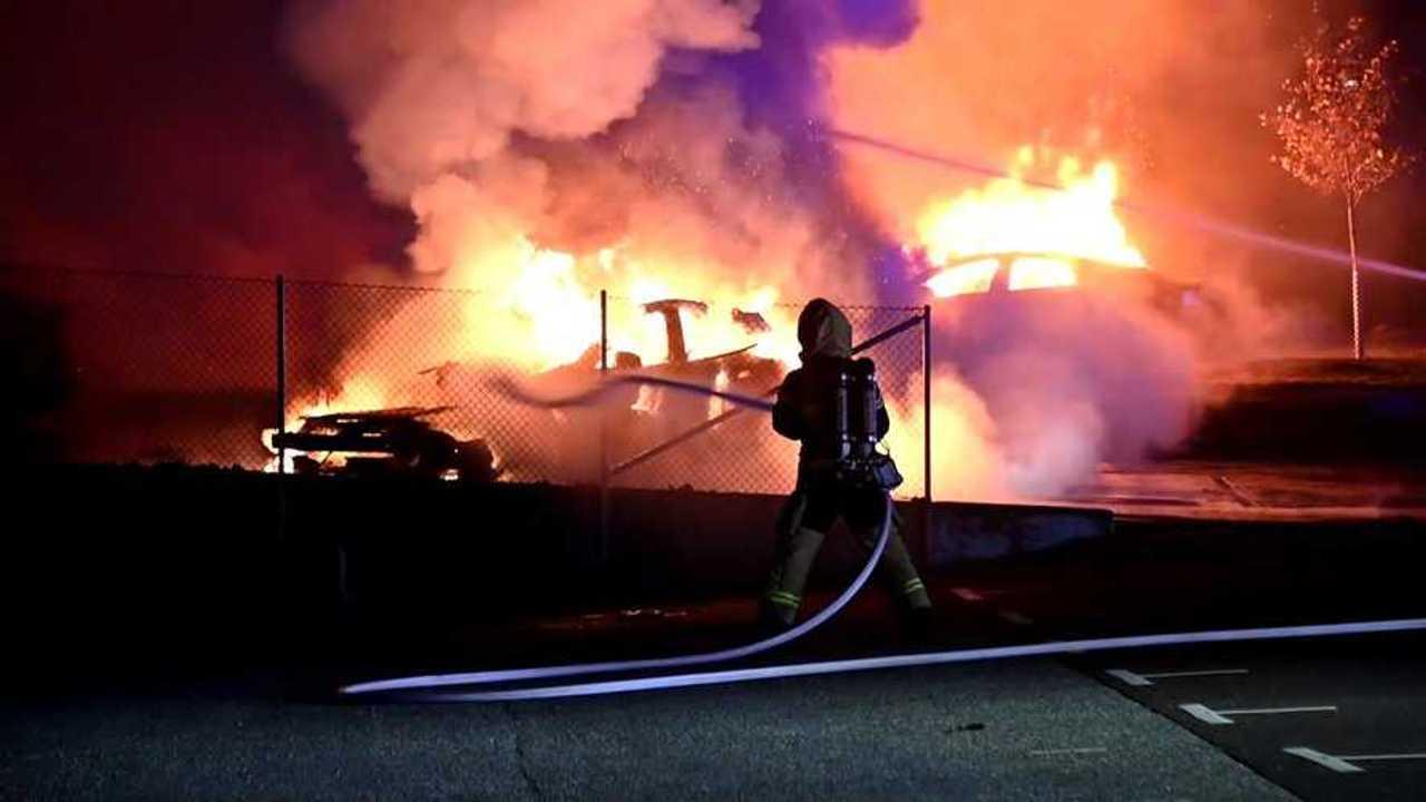 tesla burning firefighter extinguishing