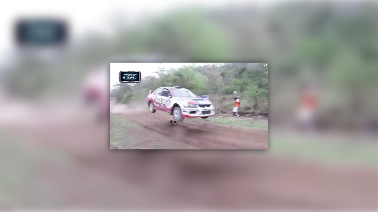 Rally car jumps dog