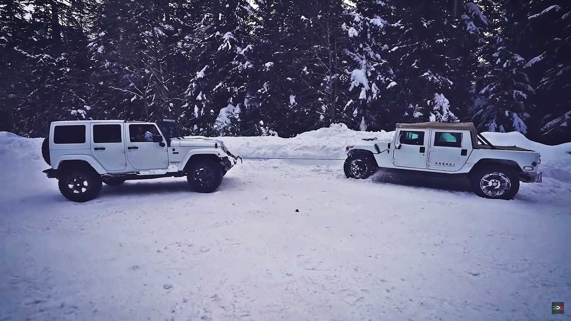 Watch Jeep Wrangler Try To Free Hummer H1 Stuck In Snow