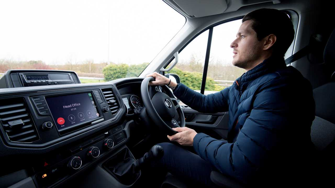 Van driver using hands-free phone while driving