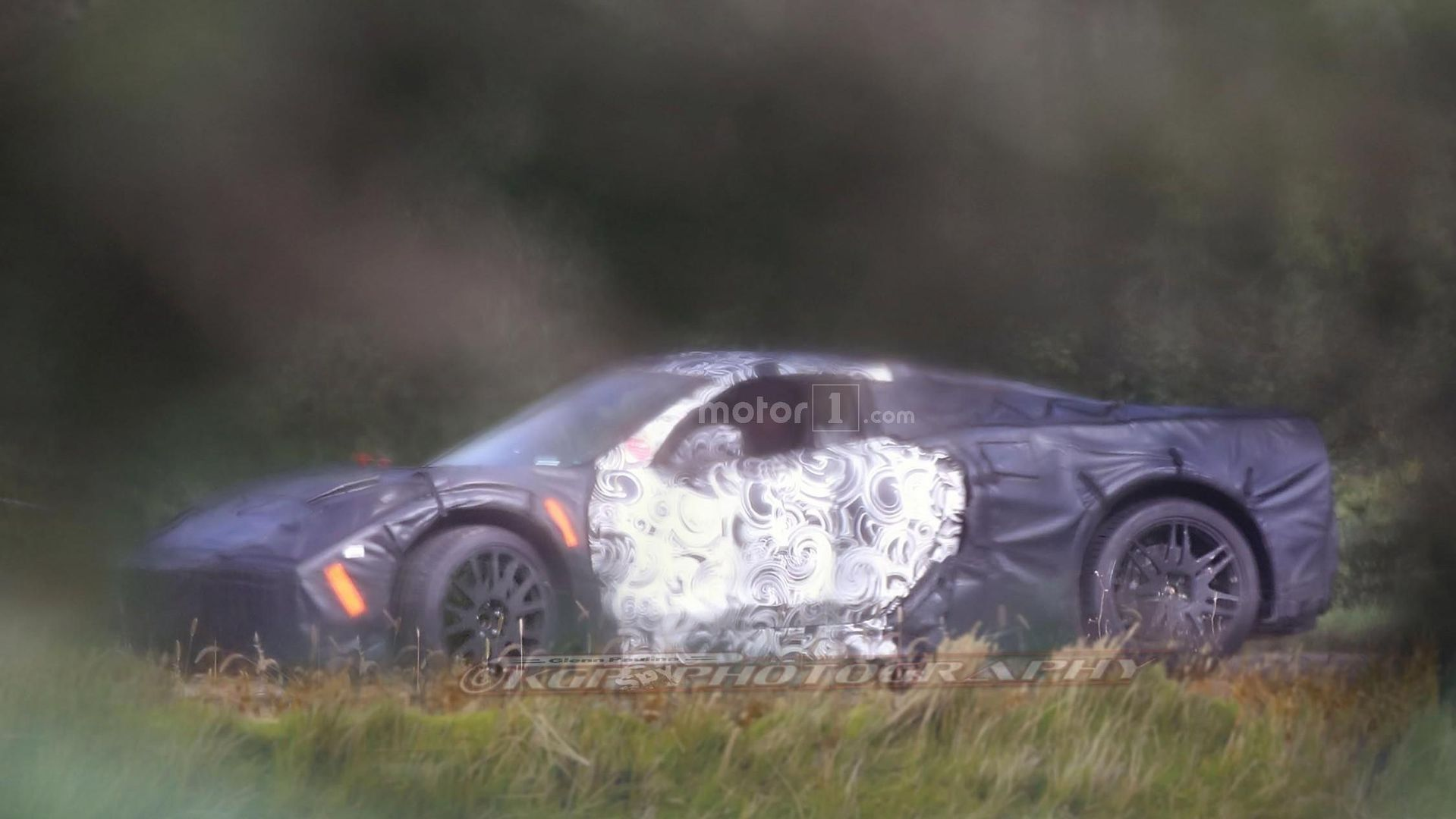 mid engine corvette spied in detail for first time