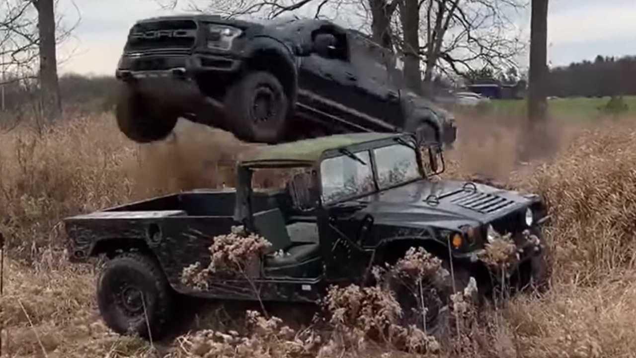 Ford Raptor Jumps Hummer H1