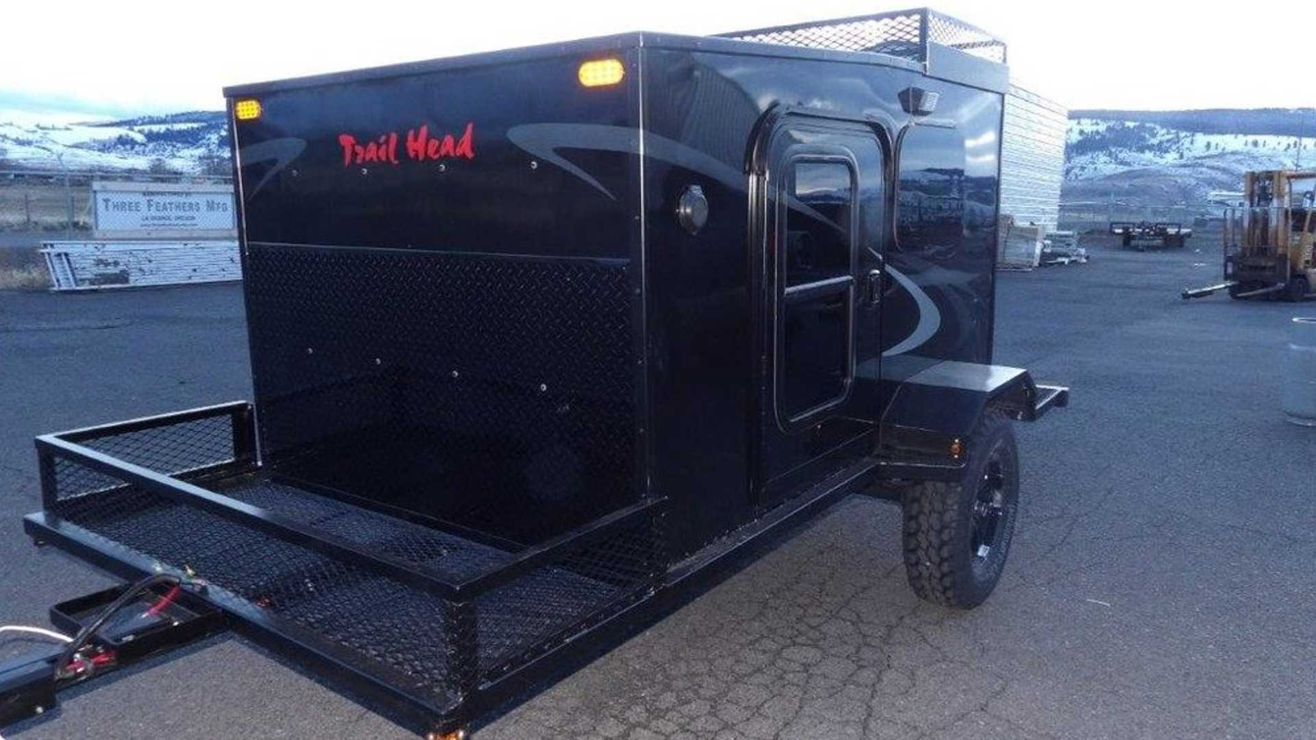 This Towable Camper Comes Standard With A Chainsaw