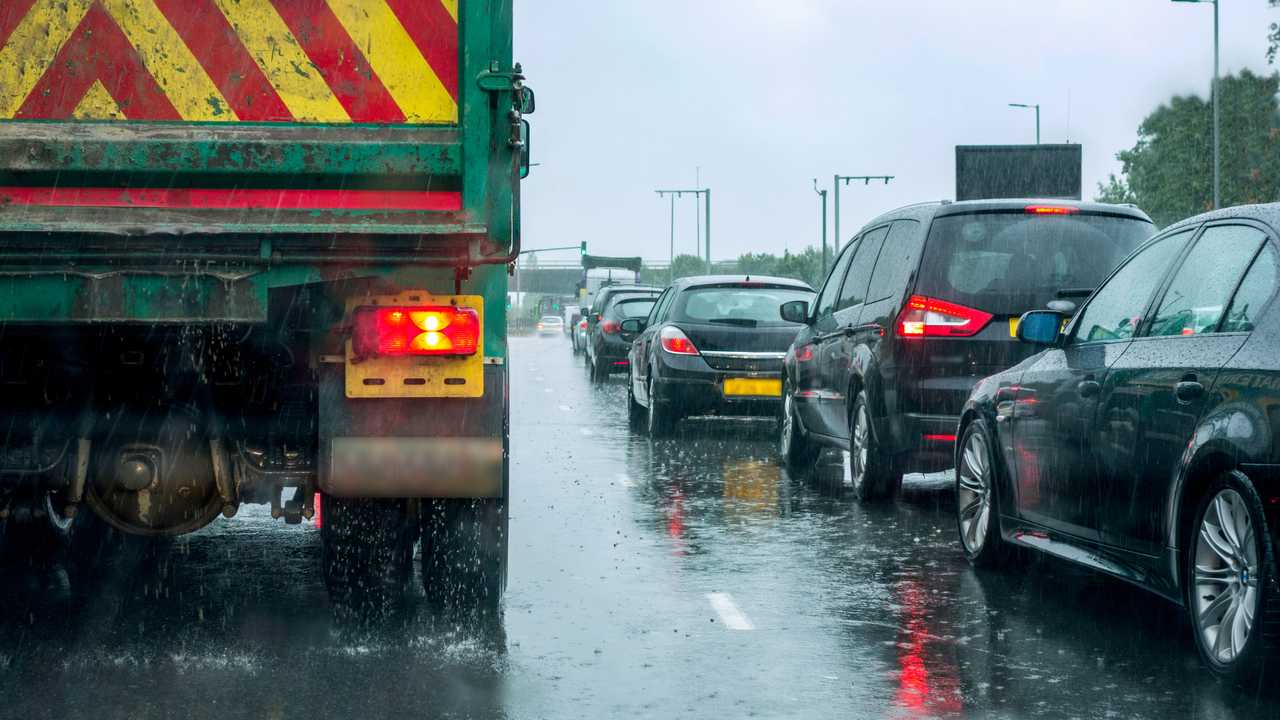 HGV truck in London traffic during heavy rain