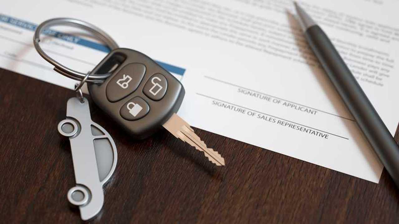 Car loan agreement with car keys