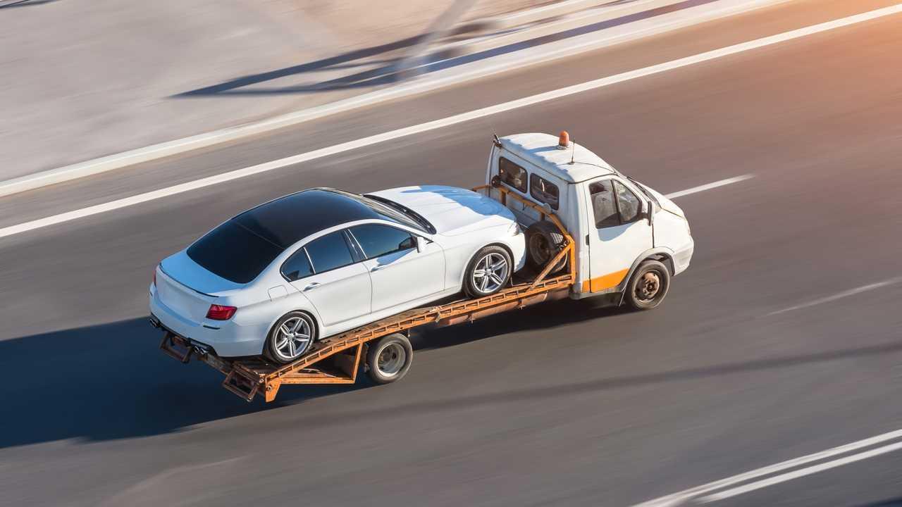 Recovery breakdown lorry on motorway transporting car