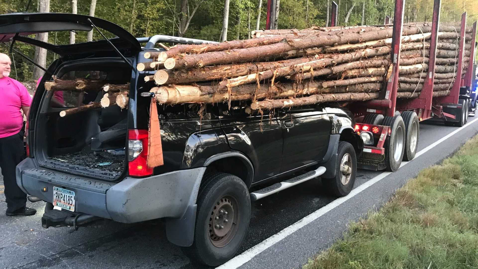 Driver Somehow Survives After Nissan Xterra Gets Impaled By Logs