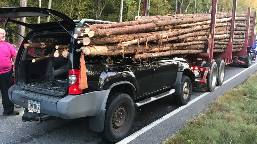 Nissan SUV gets impaled by logs as driver miraculously survives